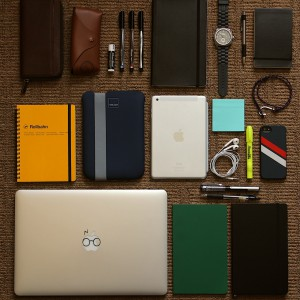 notepads, computer, ipad, pens, layed out neatly